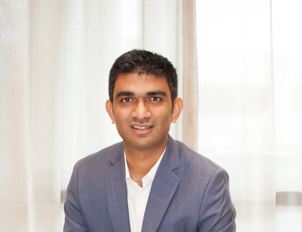 Official headshot of Rinkesh Patel, President and guiding force behind RAM Hotels.